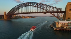 Aerial footage of Ferry tilt up to Sydney Harbour Bridge Stock Footage