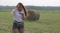 Beautiful girl enjoying fresh air use smartphone - stock footage