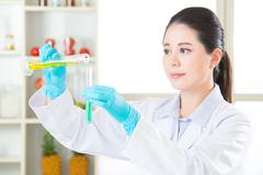chemistry researchers observing indicator color shift - stock photo