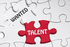 HIRING concept. Missing Piece Jigsaw Puzzle with word Talent Wanted Stock Photos