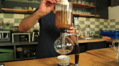 The man is making Syphon Coffee Stock Footage