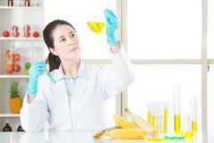 Asian female scientist drop the cure for genetic modification Stock Photos