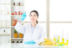 female scientist research on touch screen for gmo food - stock photo