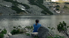Young woman admire lake super slow motion Stock Footage