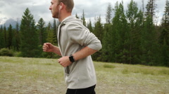 Trail running man on mountain path exercising Stock Footage