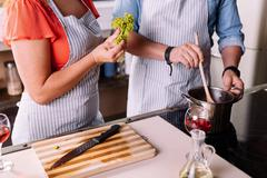 Close up of hands cooking a dinner Stock Photos