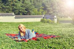 Portrait of young woman rest in the park smiling Stock Photos