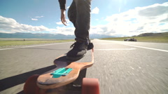 Close-up skateboarder boy riding outdoor Stock Footage