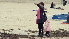 Lady filming photographing with a smart phone at the beach Stock Footage