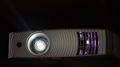 Video projector lightened at night Stock Footage