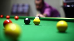 Man hitting the white ball during pool match Stock Footage