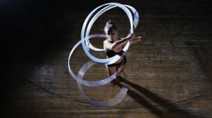 Art gymnastics. Dexterity woman rotate many hula hoop on scene. Top view. Stock Footage