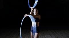 Professional female circus acrobat rotate hula hoop on scene Arkistovideo