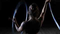 Professional female circus acrobat rotate hula hoop on scene Stock Footage