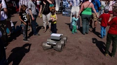 Boy control moon robot, kids study robotic rover at public science event Stock Footage