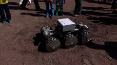 Children surround Moon robot at European science and modern technology open air Stock Footage