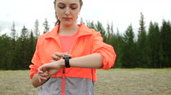 Runner using smartwatch fitness tracker and heart rate monitor watch jogging on Stock Footage