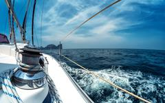 Close up of the winch on the sailing vessel moving in the sea Stock Photos