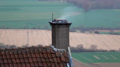 Chimney with smoke on the roof with shingles Stock Footage
