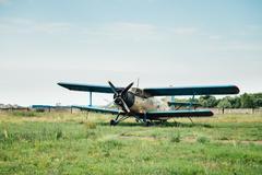 Airplanes standing on green grass. Ukraine, 2016 Stock Photos