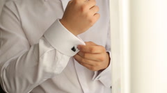 Closeup of a hand man how wears shirt and cufflink, man dressed in the wedding Stock Footage