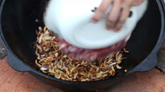 Pilaf, pilaw, plov, rice with meat in pan. Cooking process Stock Footage