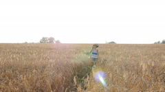 Young man with acoustic guitar at the wheat field Stock Footage