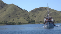 4k Crossing indonesian boat with people at sunny islands in Flores Sea Stock Footage