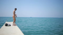 Man plunging in the water. tourist swims in the sea. Blue water and waves Stock Footage