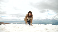 Happy woman jumping at winter mountains, active female enjoying nature, girl Stock Footage