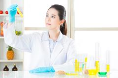 Asian female scientist try to breakthrough genetic modification food Stock Photos