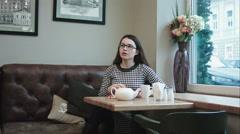 Woman swear tea in the cafe Stock Footage