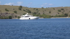 4k Elegant yacht lying at anchor at sunny islands in Flores Sea Stock Footage