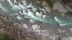 Mountain river flowing through stones Stock Footage