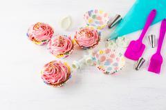 Pink homemade cupcakes  and cookware Stock Photos