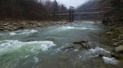 Landscape with old bridge over river in Carpathians Stock Footage