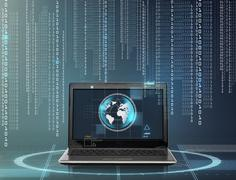 laptop computer with earth globe on screen - stock photo