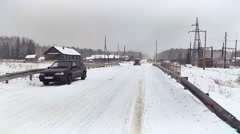 Road Traffic in the Village. Winter Stock Footage