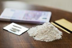 close up of crack cocaine drug dose and money - stock photo