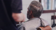 Hair stylist giving haircut to customer Stock Footage