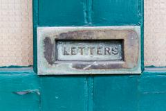 close up of vintage mailbox - stock photo