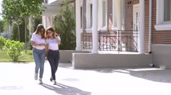 Concept of good news two girls dance in the street after reading message Stock Footage