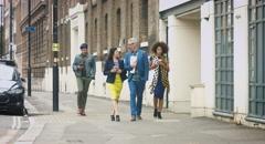 Businesspeople walking on footpath Stock Footage