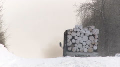 Truck Brining Logs Down the Hill. Winter Stock Footage