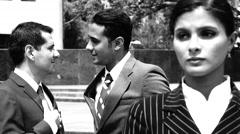 Business Men Discuss Female Coworker Vintage Shot Stock Footage