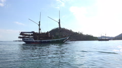 4k Beautiful indonesian sailing ship at sunny islands in Flores Sea Stock Footage