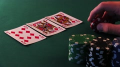 Poker Player is Nervous and Makes a Bet in Poker - stock footage