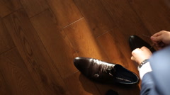 Man trying leather shoelaces before the wedding - stock footage