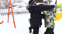 Elementary School Kids Wrestling on the Snow Stock Footage