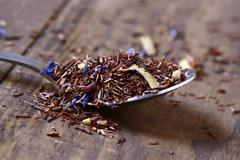 Rooibos tea mixed with flowers, dry fruits and herbs Stock Photos